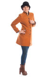 Portrait of a girl dressed in orange coat Stock Image