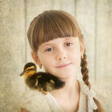 Portrait of girl with duckling on shoulder. Girl with duckling on shoulder Royalty Free Stock Images