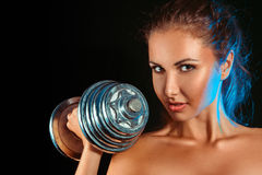 Portrait of girl with dumbbells in hand Royalty Free Stock Photo
