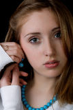 Portrait of the girl with earrings Stock Image