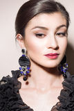 Portrait of a girl with earrings Stock Images