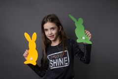 Portrait girl easter. Positive happy traditional bunnies paper event childhood Stock Images