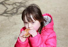Portrait of girl eating baguette Royalty Free Stock Photo