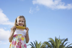 Portrait Of Girl Eating Corn On The Cob Stock Image
