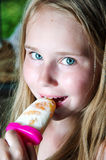 Portrait of girl eating popsicle and smile Stock Photos
