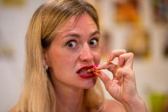 Portrait girl eats big tiger prawn, thailand, pattaya, close up royalty free stock images