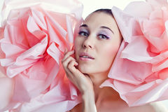 Portrait of girl. Emotions. Tenderness. Dreaming.Flowers. Portrait of young beautiful dreaming woman with pink roses. Emotions. Tenderness. Pink grey makeup Stock Image