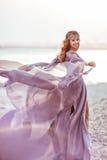 Portrait of a girl in a fairy light dress is walking Stock Image