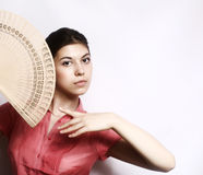 Portrait of the girl with a fan. Royalty Free Stock Images
