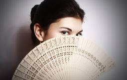 Portrait of the girl with a fan. Stock Photo