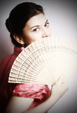 Portrait of the girl with a fan. Royalty Free Stock Photography