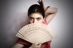 Portrait of the girl with a fan. Stock Image