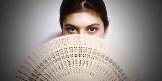 Portrait of the girl with a fan. Royalty Free Stock Photo