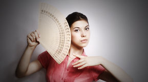 Portrait of the girl with a fan. Stock Images