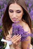 Portrait of girl with fashion makeup at lavender Stock Images