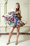 Portrait of the girl in a fashionable dress Royalty Free Stock Image