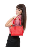 Portrait of a girl with a fashionable red handbag Stock Images