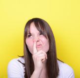Portrait of girl with finger in her nose Royalty Free Stock Photo