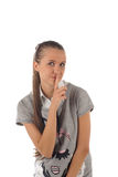 Portrait of girl with finger on lips (isolated) Stock Photo
