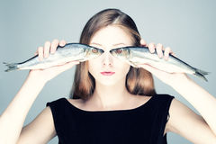 Portrait of a girl with fish. Studio photo of a young woman with the fishes Stock Photo