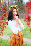 Portrait girl with flower wreath in the colorful autumn park Stock Image