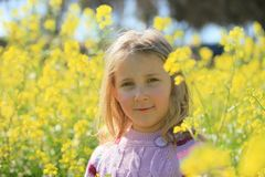 Portrait of a girl on a flowers Royalty Free Stock Photography