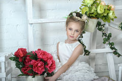 Portrait of a girl with flowers Stock Image