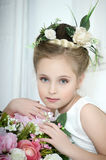 Portrait of a girl with flowers Stock Images