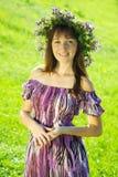 Portrait of  girl in flowers  chaplet Stock Images