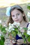 Portrait of the girl in the flowers of jasmine Royalty Free Stock Images