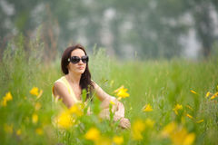 Portrait of a girl with flowers lily Royalty Free Stock Photography
