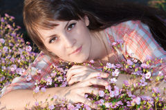 Portrait of girl in flowers. Portrait of girl on nature in flowers Royalty Free Stock Photography