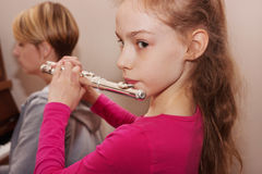 Portrait of a girl with flute Royalty Free Stock Photography
