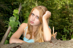 Portrait of the girl with freckles in forest Royalty Free Stock Images