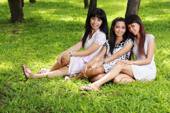 Portrait of girl friends sitting in the park Royalty Free Stock Images