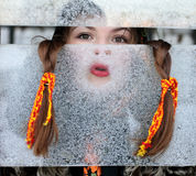 Portrait of a girl for a frosty window. Winter fun and ice. Canon 5Dmark2 Stock Images