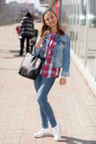 Portrait of a girl in full growth in jeans Stock Photo