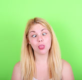 Portrait of girl with funny face against green background Royalty Free Stock Images