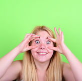 Portrait of girl with funny face against green background Royalty Free Stock Photos