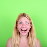 Portrait of girl with funny face against green background. This image is made in studio with model standing against colored backgrounds.Set of various conceptual Royalty Free Stock Images