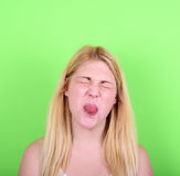 Portrait of girl with funny face against green background Stock Photography