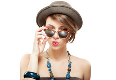Portrait of girl with funny face. Portrait of beautiful girl with funny face, holding her sunglasses with hand Royalty Free Stock Image