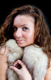 Portrait of girl with  fur Stock Photos