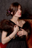Portrait of the girl with fur. On a black background studio shoot Royalty Free Stock Photo