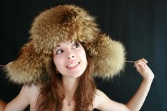 Portrait of the girl in a fur cap. Royalty Free Stock Images