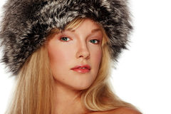 Portrait of girl in fur hat Stock Image