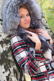 Portrait of a girl with a fur hood Royalty Free Stock Photos