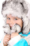 Portrait of the girl in a fur winter cap Royalty Free Stock Photo