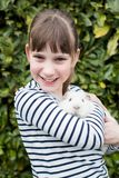 Portrait Of Girl In Garden Looking After Pet Guinea Pig. Girl In Garden Looking After Pet Guinea Pig Stock Image