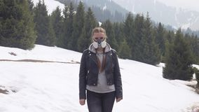 Portrait of a girl in a gas mask in nature in winter. Portrait of a girl in a gas mask in winter nature stock footage
